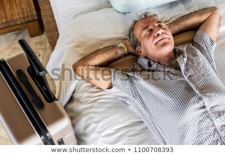 Senior man laying down on the bed Stock photo © Novic