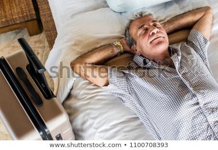 Idős férfi fekszik ágy vízszintes fotó Stock fotó © Novic