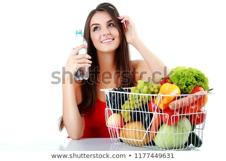 happy young woman holding a basket full of healthy food on white stock photo © vlad_star