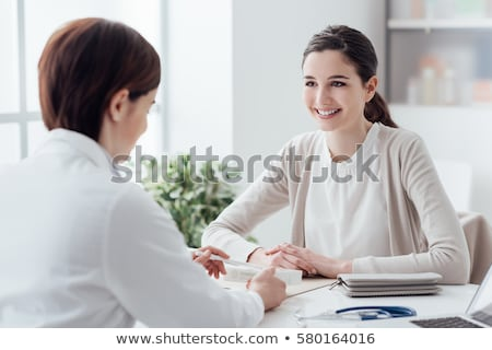 Practitioner consulting woman Stock photo © HASLOO
