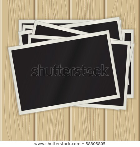 retro camera and blank instant photos on a wooden surface Stock photo © nito