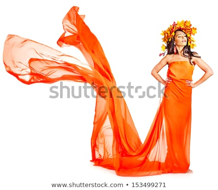 Vörös haj lány narancs ruha izolált fehér Stock fotó © Elnur