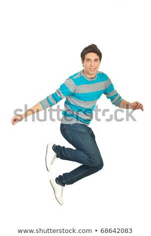 smiling young man in blue pullover and jeans Stock photo © dolgachov