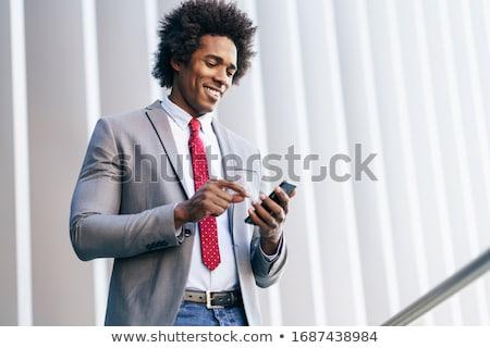 retrato · bonito · homem · de · negócios · celular · sorridente - foto stock © fouroaks