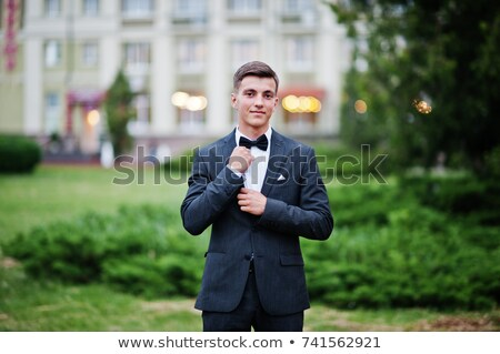 Gorgeous young man looking confidently with his arms folded Stock photo © zurijeta