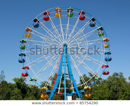 ferris wheel and yellowed trees stock photo © oleksandro