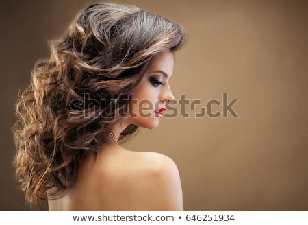 Beauty Makeup. Beautiful brunette girl with long wavy hairstyle. Stock photo © Victoria_Andreas