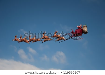 santa flying moon city stock photo © romvo