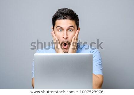 Felice setola uomo guardando computer portatile foto Foto d'archivio © deandrobot