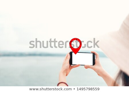 Woman holding guiding direction arrow sign Stock photo © stevanovicigor