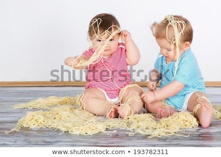 Happy baby funny messy eater Stock photo © phakimata