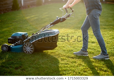 Man with push lawnmower Stock photo © IS2
