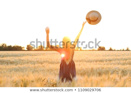 Young girl throwing wheat in field Stock photo © IS2