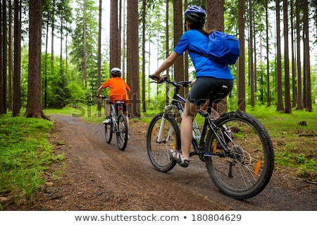 Two boys racing on country lane Stock photo © IS2