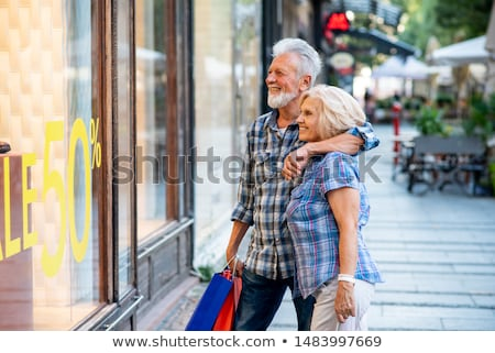 Smiling older couple window shopping Stock photo © IS2