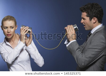 Two businesswomen using tin cans Stock photo © IS2