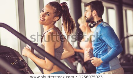 Couple training on a treadmill in a sport centre  Stock photo © dashapetrenko