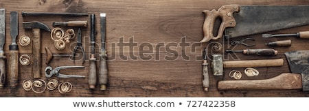 carpenter with wood, hammer and chisel at workshop Stock photo © dolgachov