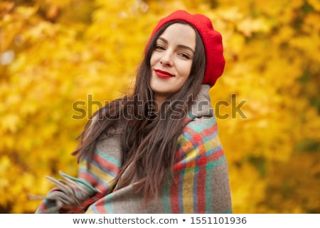 beautiful cute woman standing in park near tree reading book stock photo © deandrobot