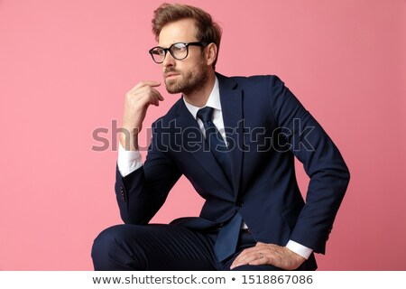 portrait of smart casual man in navy suit thinking Stock photo © feedough