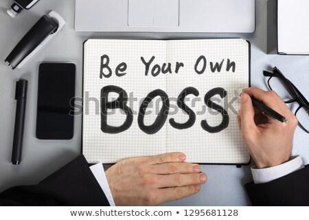 ビジネスマン 書く 独自の 上司 文字 ノートブック ストックフォト © AndreyPopov