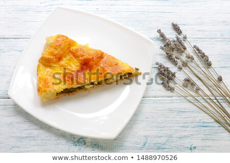 Plate with one piece of lavender cake  Stock photo © dashapetrenko