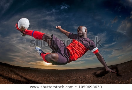 Boy Practicing Football. Young Soccer Players Kicking Balls stock photo © matimix