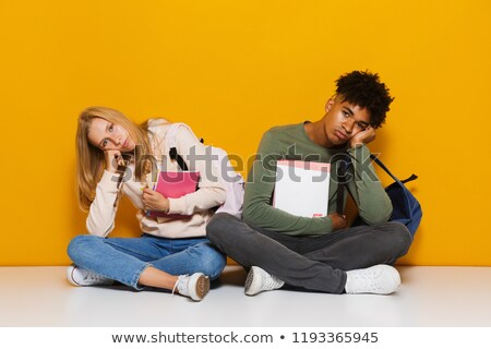 Photo of bored or upset students 16-18 using holding exercise bo Stock photo © deandrobot