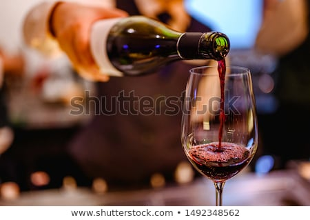 White and red wine pouring into glasses Stock photo © Alex9500