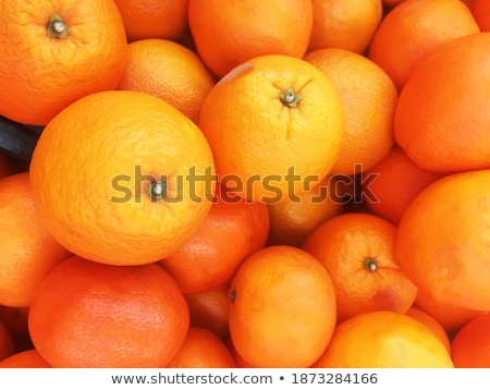 close up of peeled mandarin on slate table top Stock photo © dolgachov