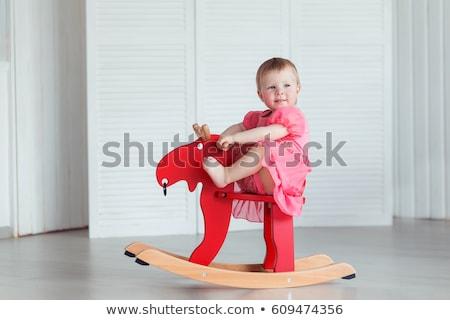 Adorable toddler girl sitting on rocking horse  Stock photo © dashapetrenko