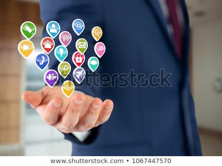 Empresário mão aplicação ícones escritório turva Foto stock © wavebreak_media