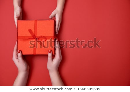 Hands of parent giving a x-mas gift to child. Stock photo © choreograph
