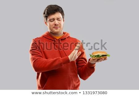 jeune · homme · manger · Burger · sourire · visage · yeux - photo stock © dolgachov