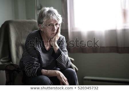 worried senior woman at home felling very bad Stock photo © Lopolo