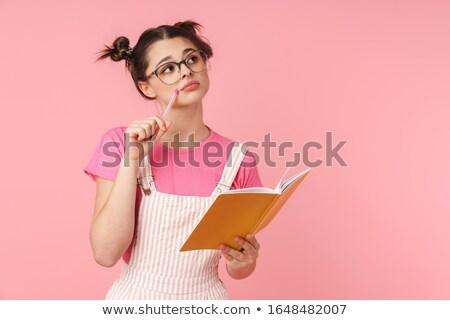 Fotó komoly bájos lány tart füzet Stock fotó © deandrobot