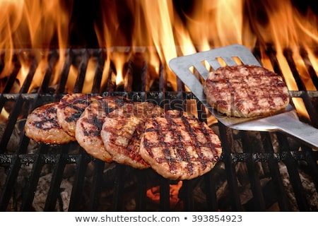 grill beef patty on a spatula Stock photo © zkruger