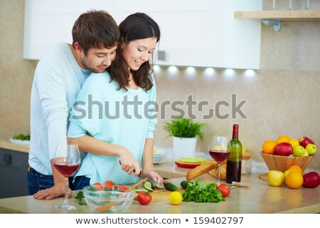 portrait of a woman cooking with her husband stock photo © photography33