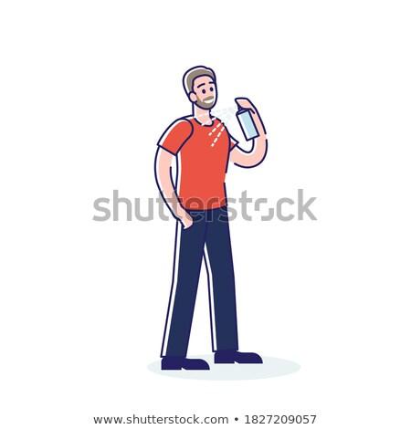 Man using underarm deodorant perspirant spray stock photo © lovleah