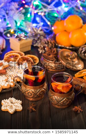 Two orange alcohol cocktails with mandarines and light candles Stock photo © karandaev