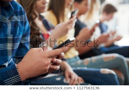 student · praten · mobiele · telefoon · vrouwelijke · vrouwen - stockfoto © aremafoto