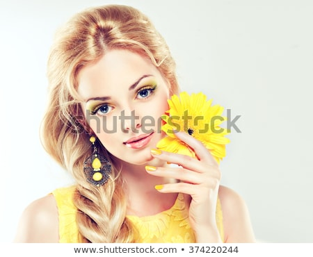 beautiful girl with gerbera stock photo © zastavkin