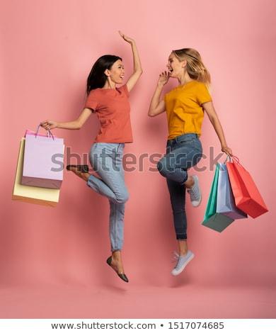 Vásárlás lányok sziluettek nő jókedv pénzügy Stock fotó © bokica