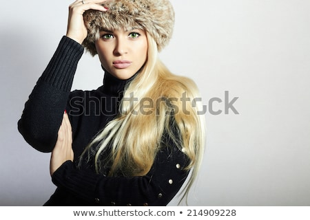 Pretty blonde with fur hat Stock photo © stryjek