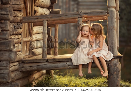 two little sisters in the summer garden stock photo © dashapetrenko