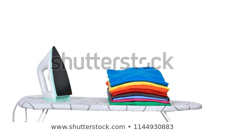 electric iron and pile of clothes Stock photo © marylooo