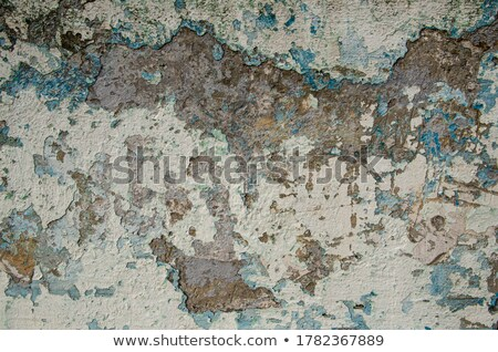 Old blue wall with flaky gray paint.  Stock photo © bogumil
