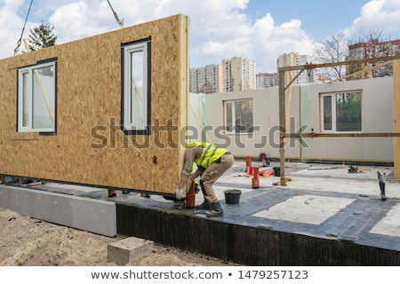 Montage of builder working on wooden house frame Stock photo © photography33