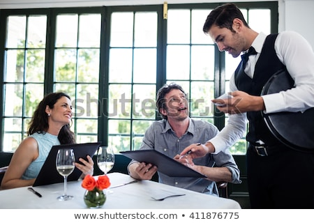 Smart waiter taking order Stock photo © photography33