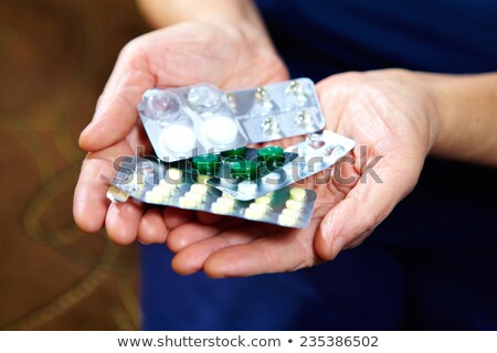 Old woman with a lot of medicine  to take Stock photo © photography33